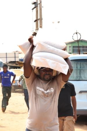 TB Joshua Carrying Rice
